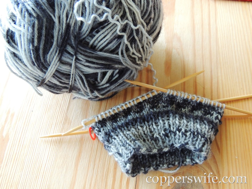 grey and white sock knitting
